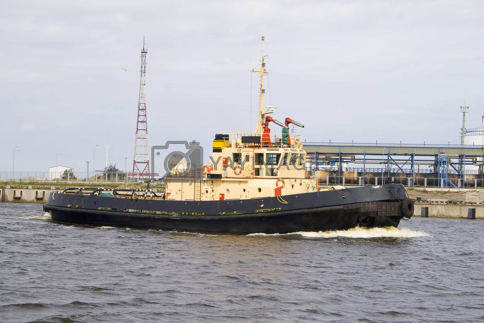 One of tugboats near the ferry terminal in the harbor in Ventspils, Latvia.