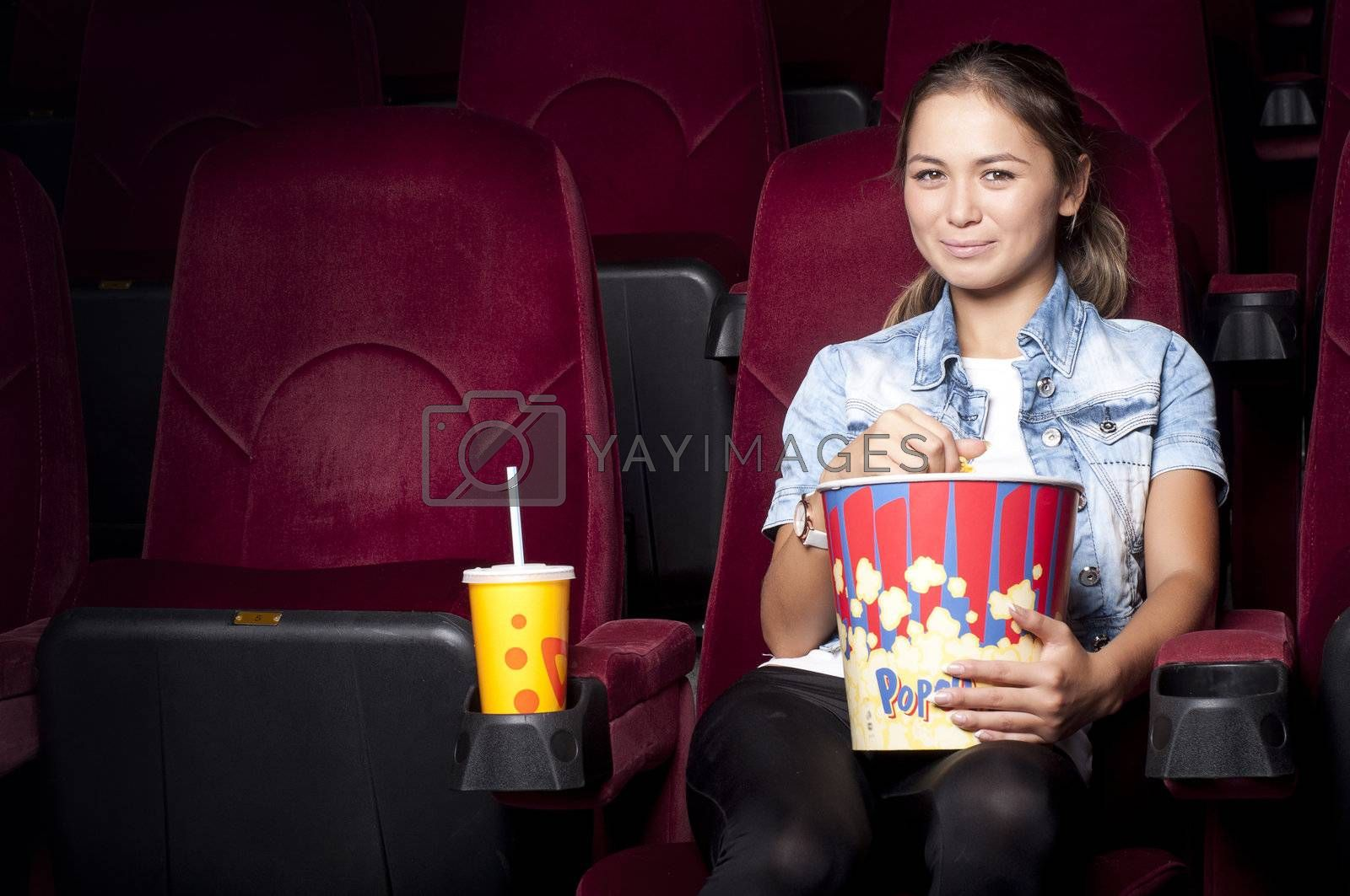woman at the cinema eat popcorn by adam121