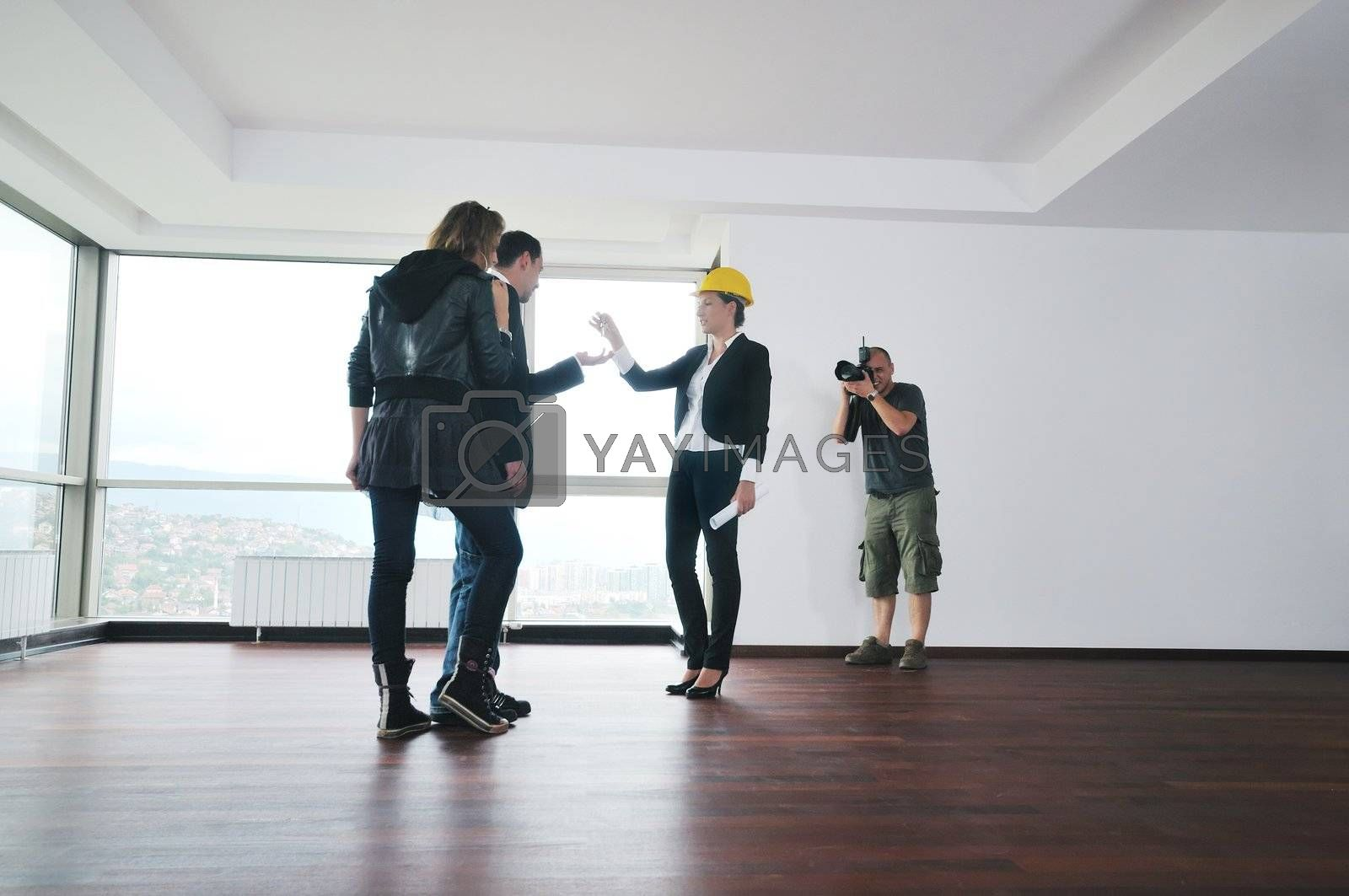 profesional stock photographer on stock photo session with young models