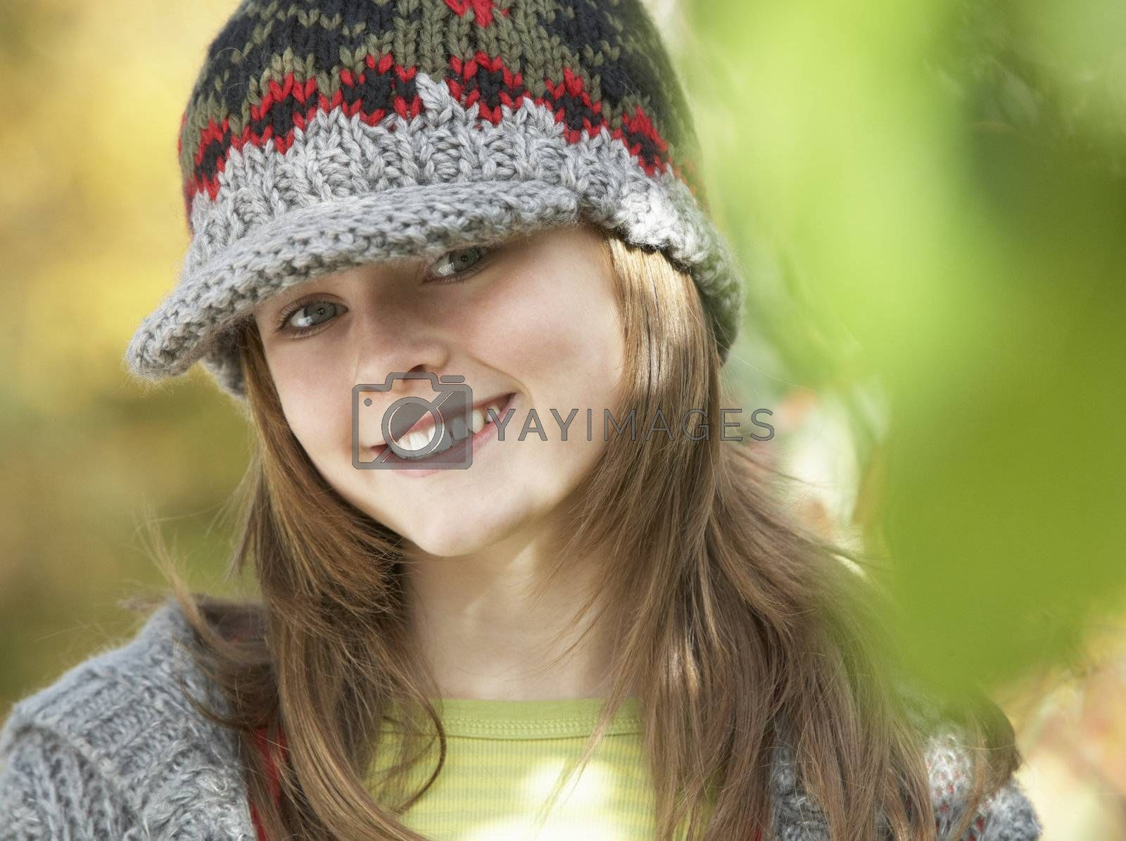 Head And Shoulders Of Young Girl In Autumn Woodland