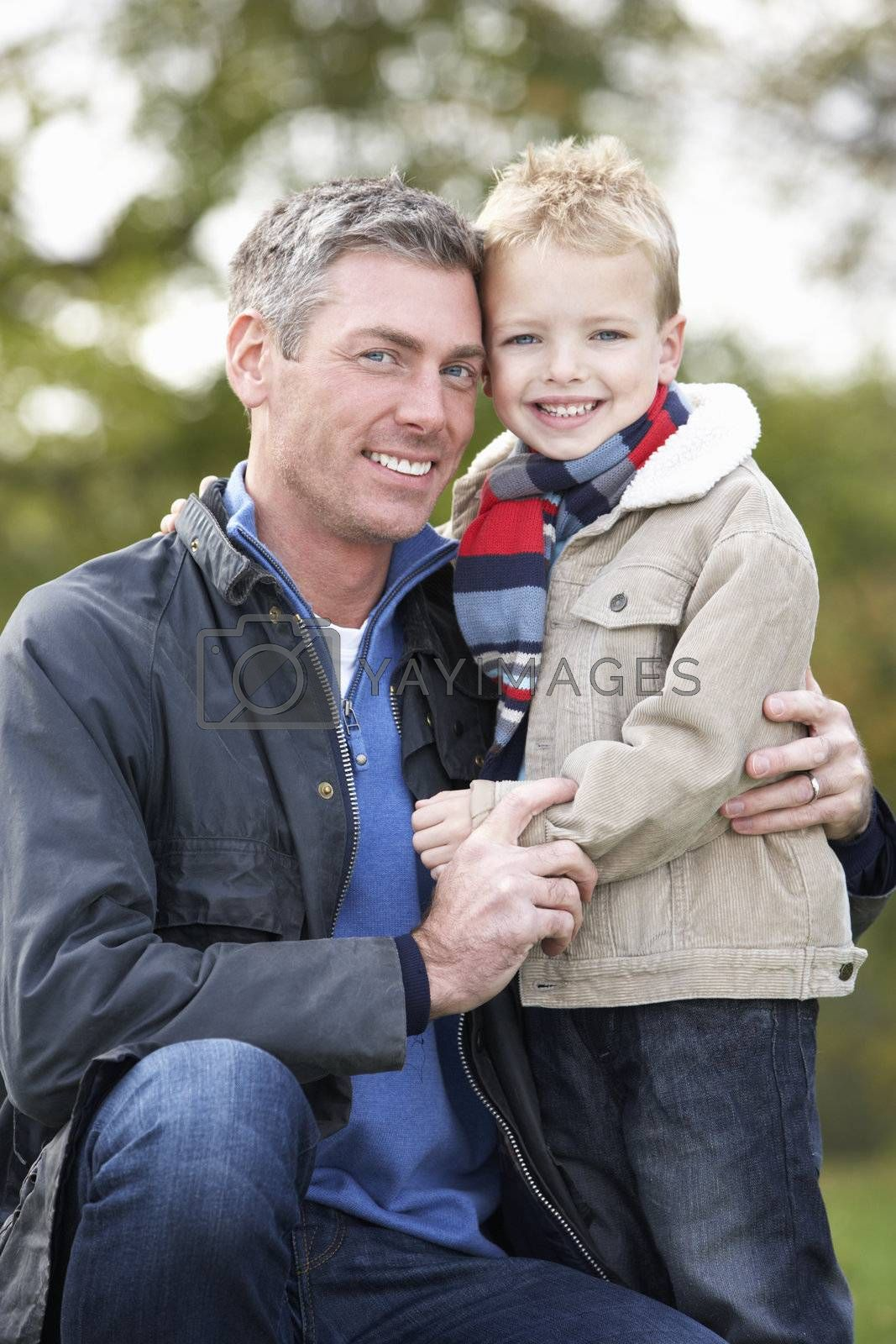 Father And Son Hugging On Outdoor Autumn Walk