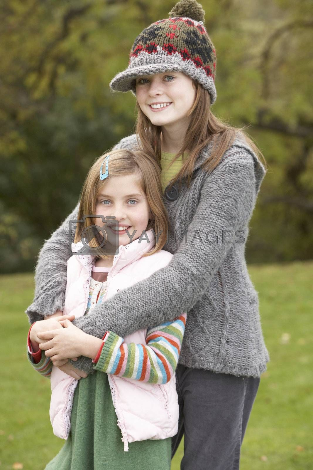 Two Sisters On Walk In Autumn Countryside