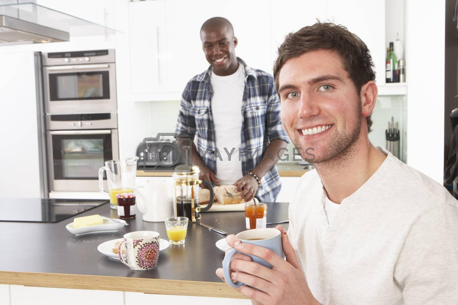 Two Young Men Preparing Breakfast In Modern Kitchen