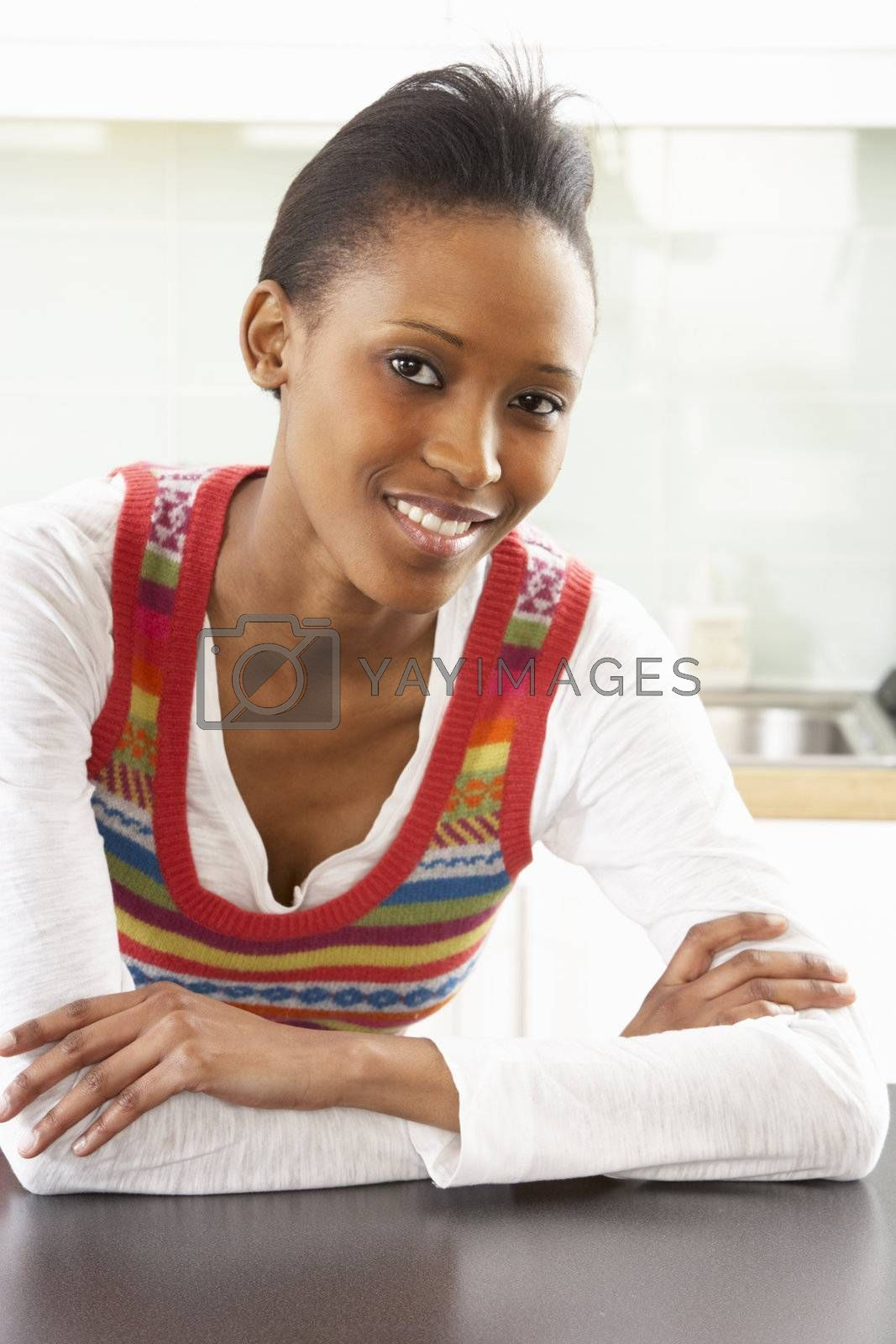 Young Woman Relaxing In Modern Kitchen
