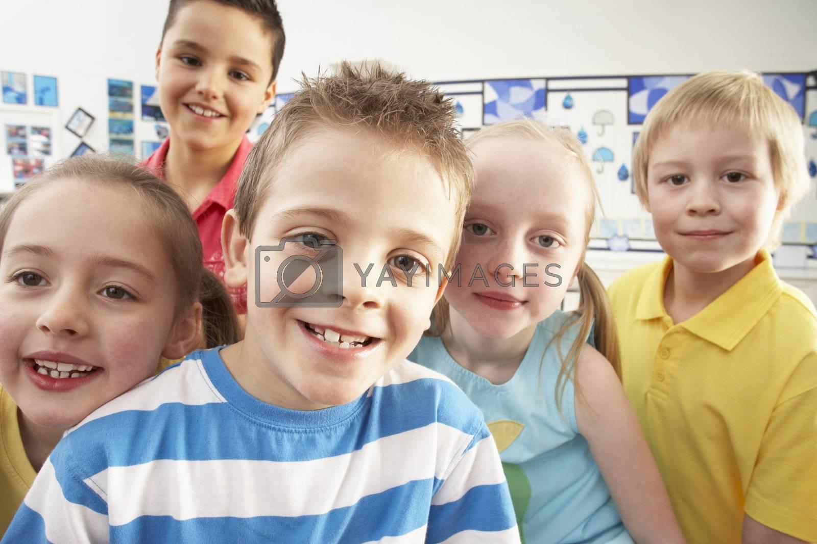 Group Of Primary Schoolchildren In Classroom