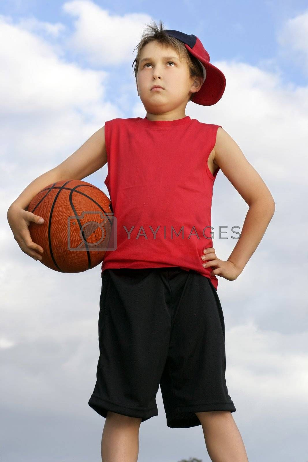 Standing child holding a basketball by lovleah