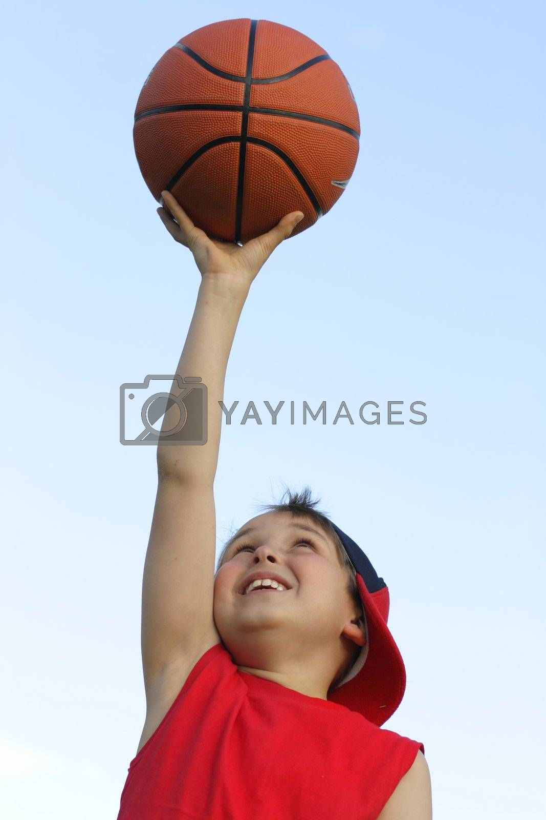 Boy with a basketball by lovleah