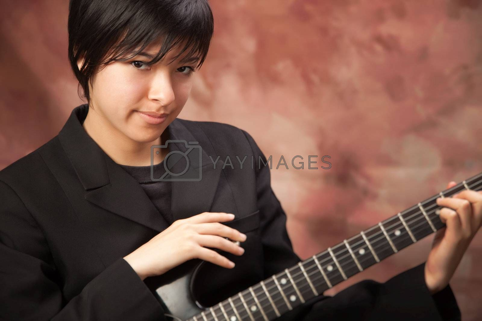 Multiethnic Girl Poses with Electric Guitar by Feverpitched