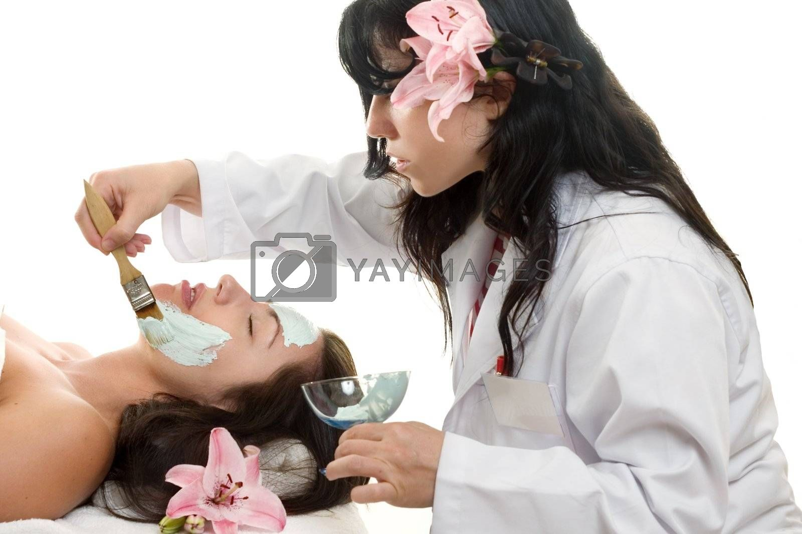 Esthetician  applying spa treatment by lovleah