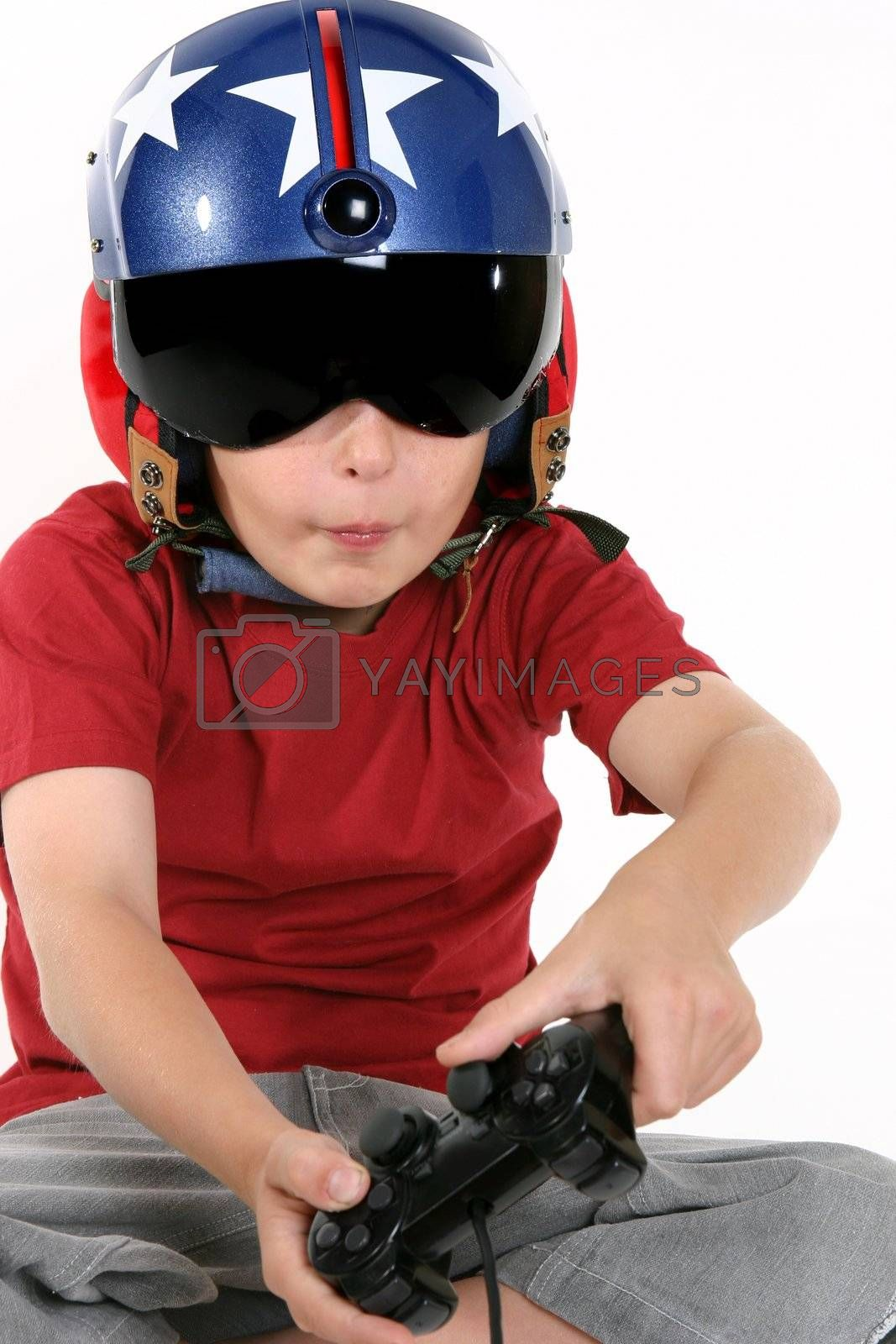 Child in helmet playing a flight simulator by lovleah