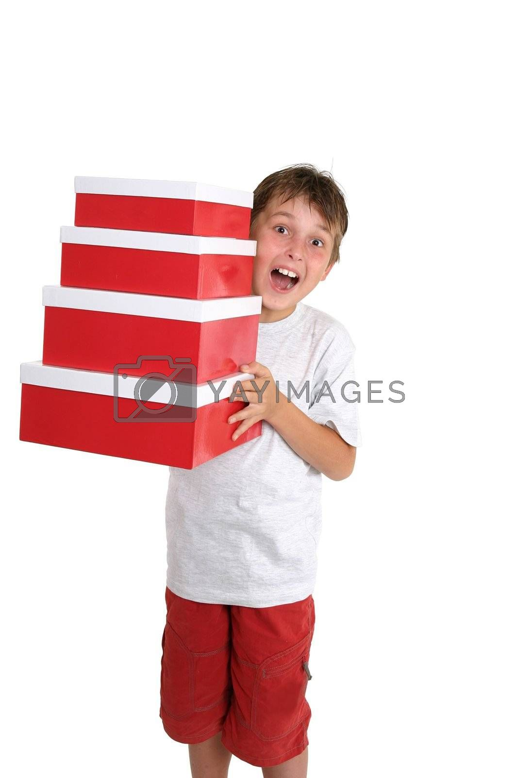 Excited child carrying gift boxes by lovleah