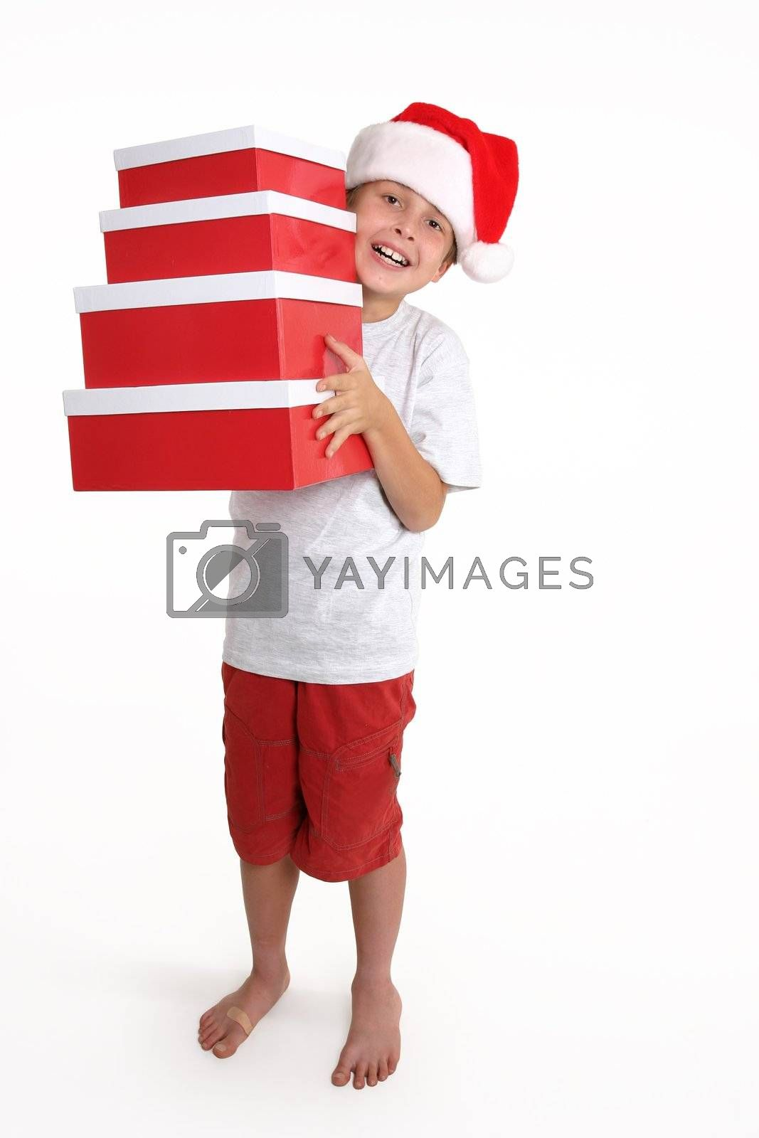 Child holding a stack of gift boxes by lovleah