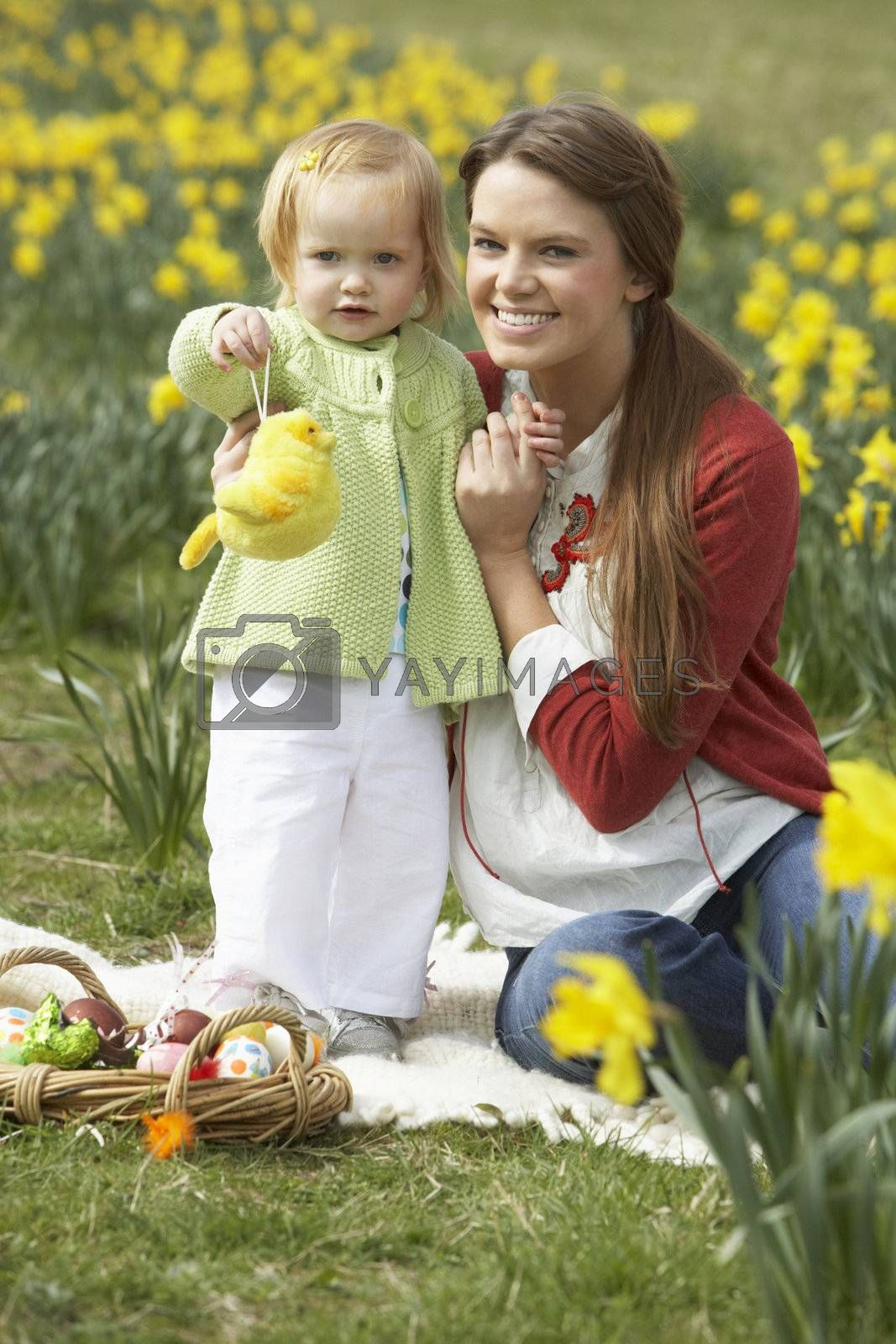 Mother And Daughter In Daffodil Field With Decorated Easter Eggs