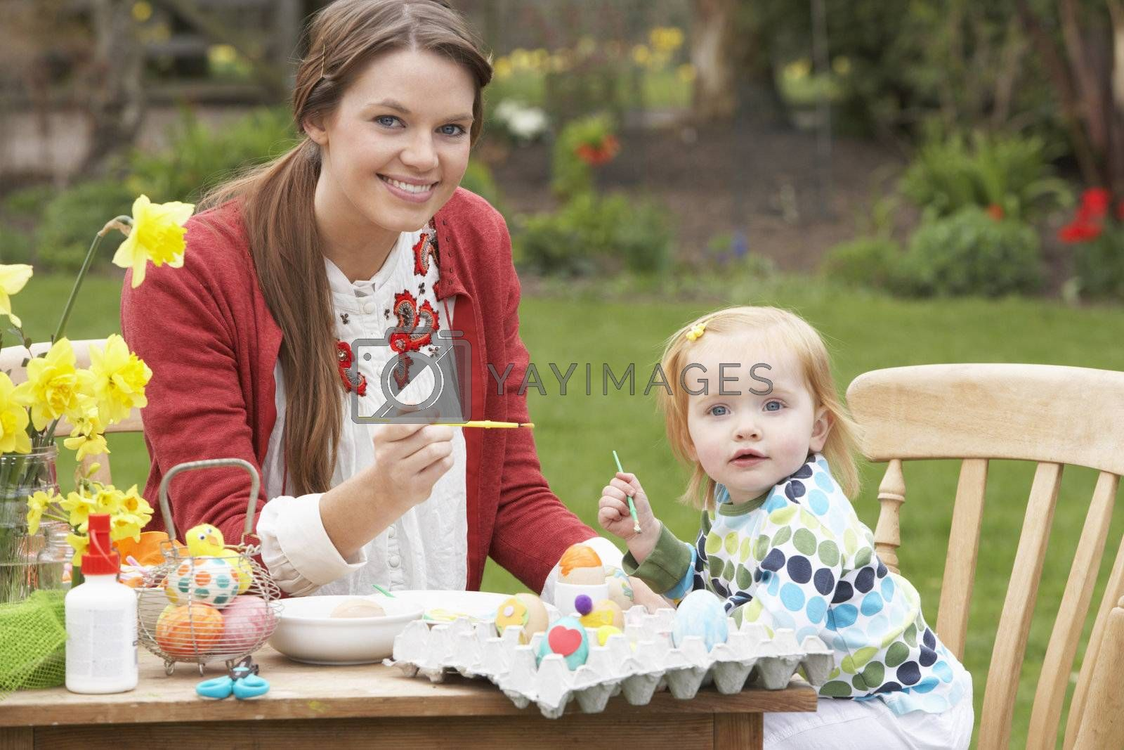 Mother And Daughter Painting Easter Eggs In Gardens