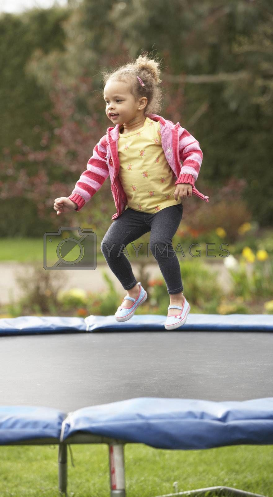 Royalty free image of Girl Playing On Trampoline by omg_images