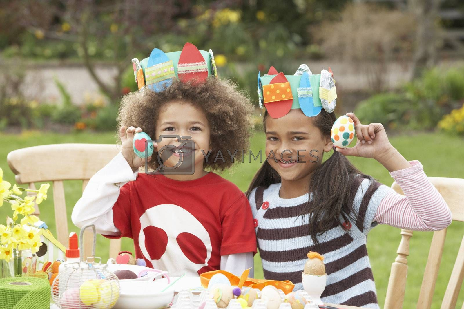 Children Painting Easter Eggs In Gardens by OMG Images