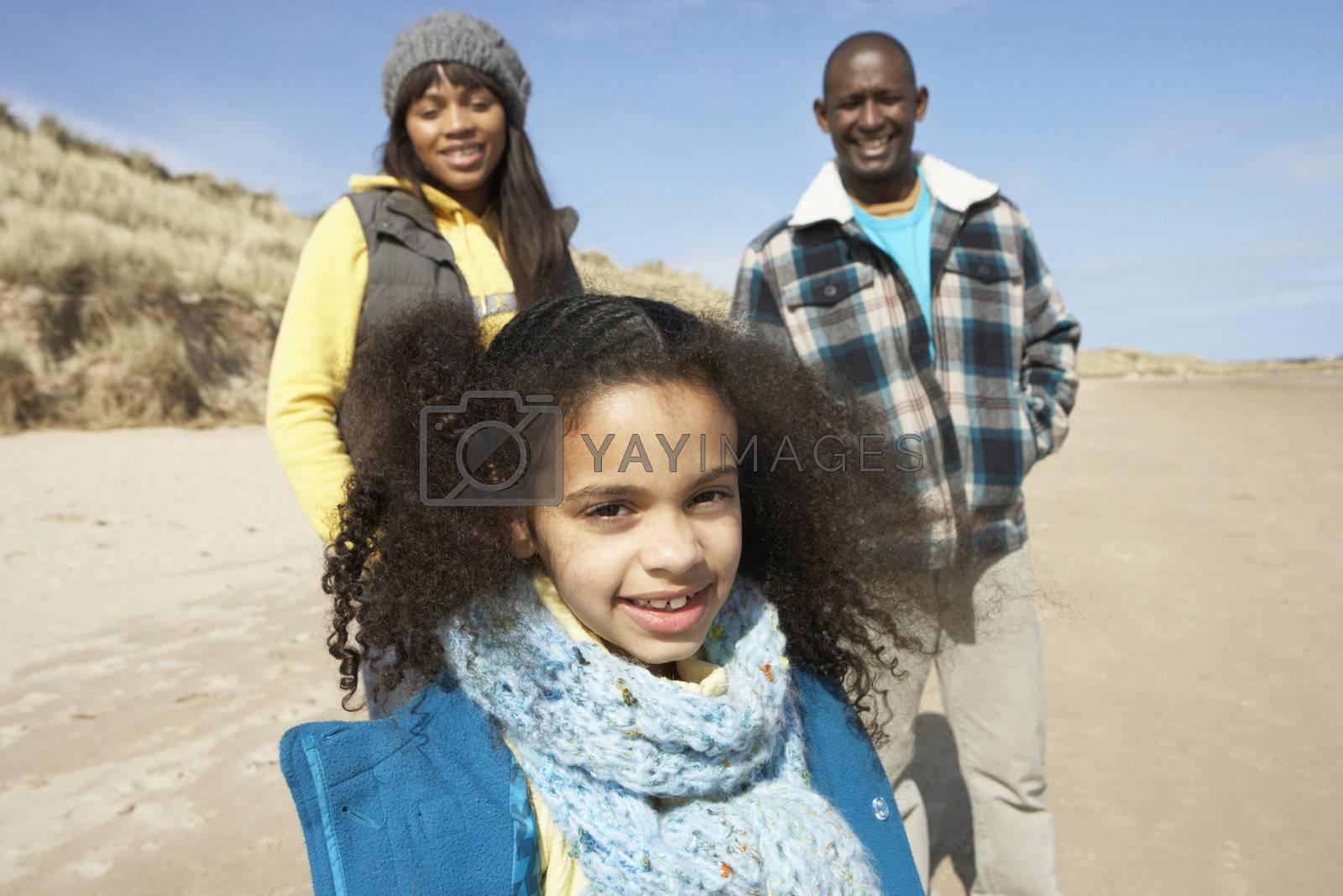 Family Wallking On Winter Beach
