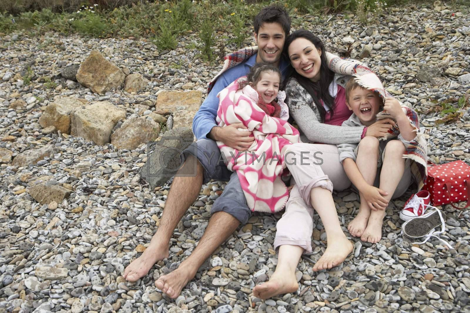 Royalty free image of Family on beach with blankets by omg_images