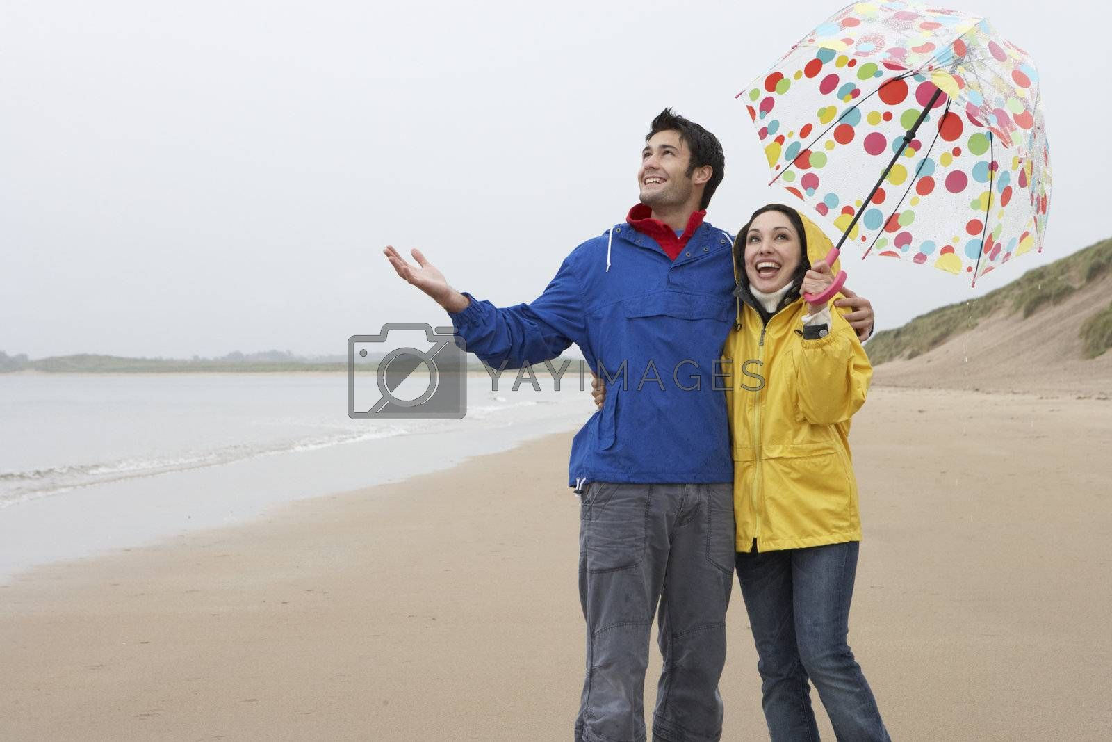 Royalty free image of Happy couple on beach by omg_images