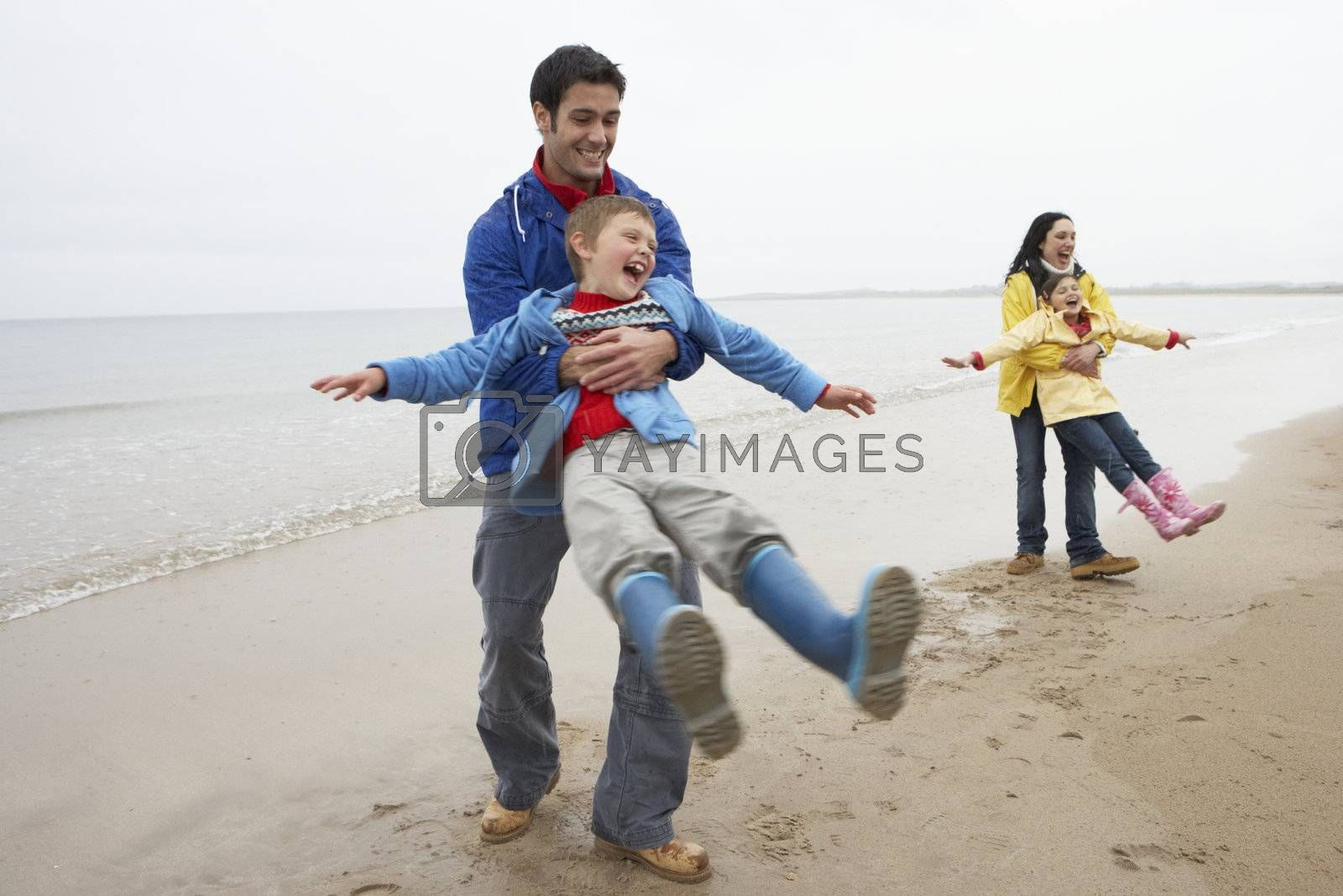 Royalty free image of Family playing on beach by omg_images