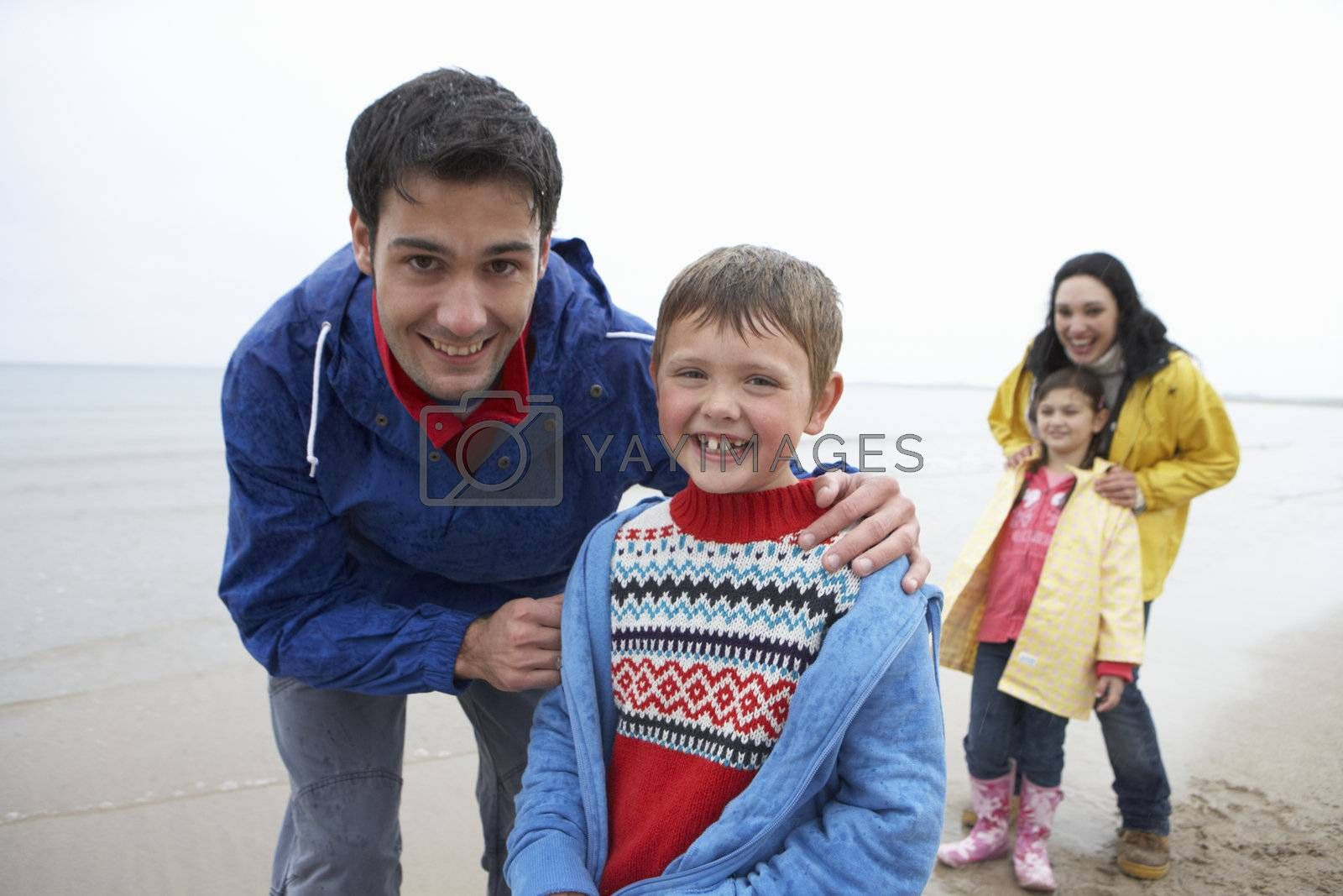 Royalty free image of Happy family on beach by omg_images