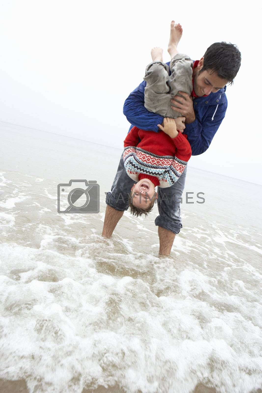 Royalty free image of Happy father with son on beach by omg_images