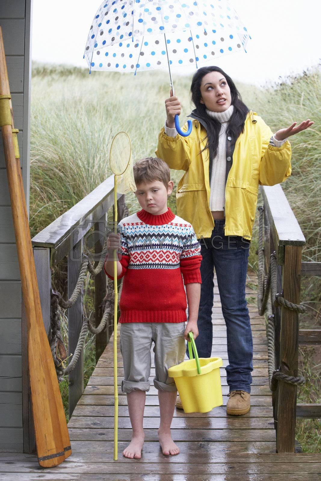 Sad woman and child with umbrella