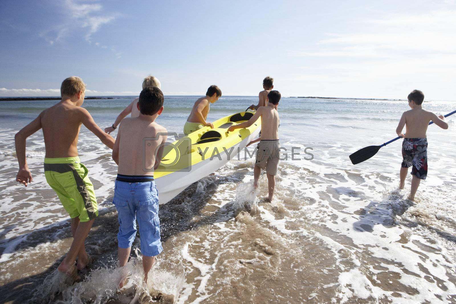 Teenage boys kayaking