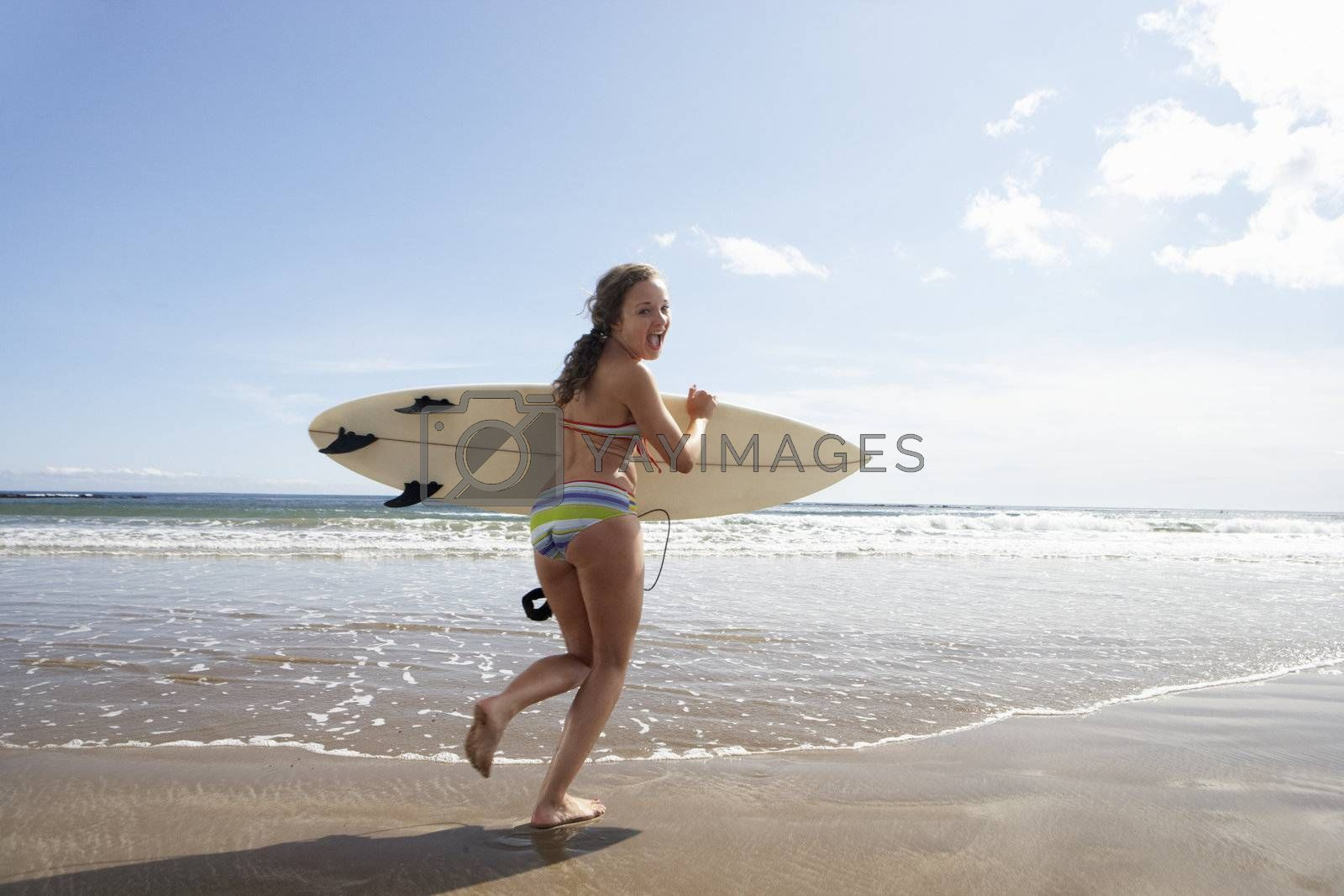 Teenager girl with surfboard