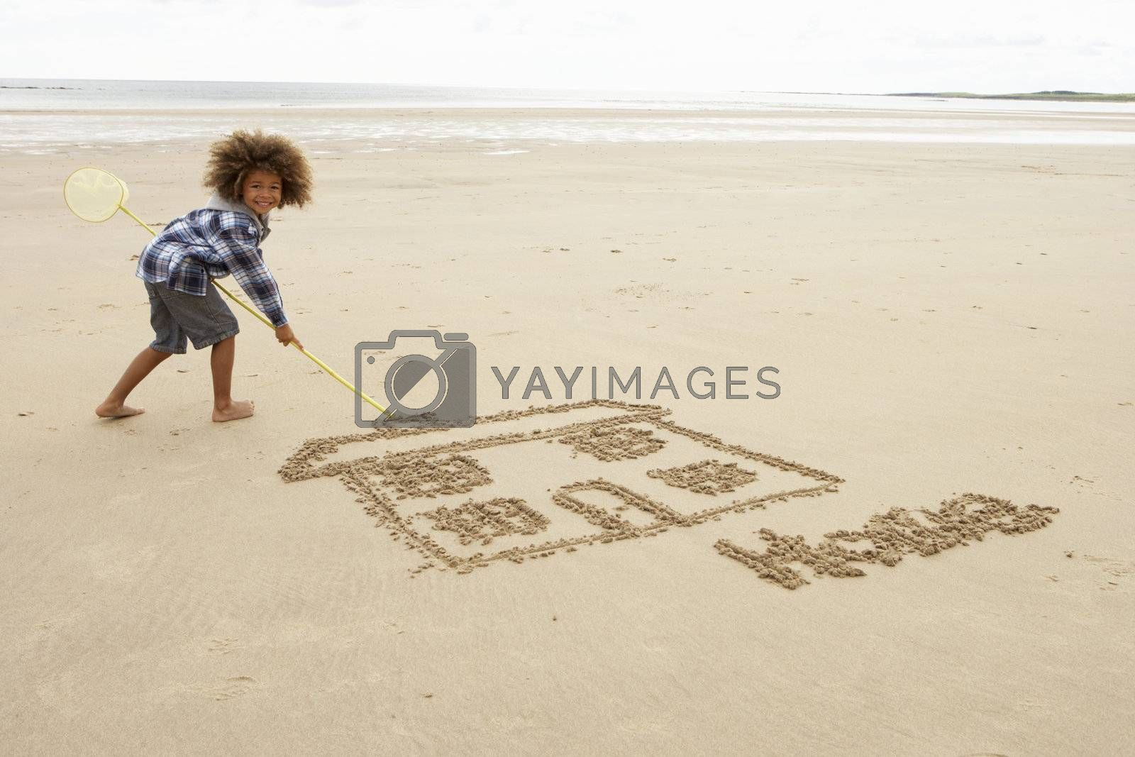 Boy drawing in sand