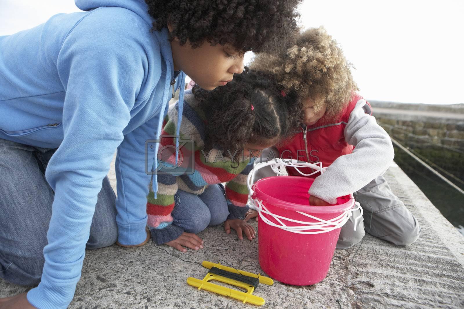 Children fishing for crabs