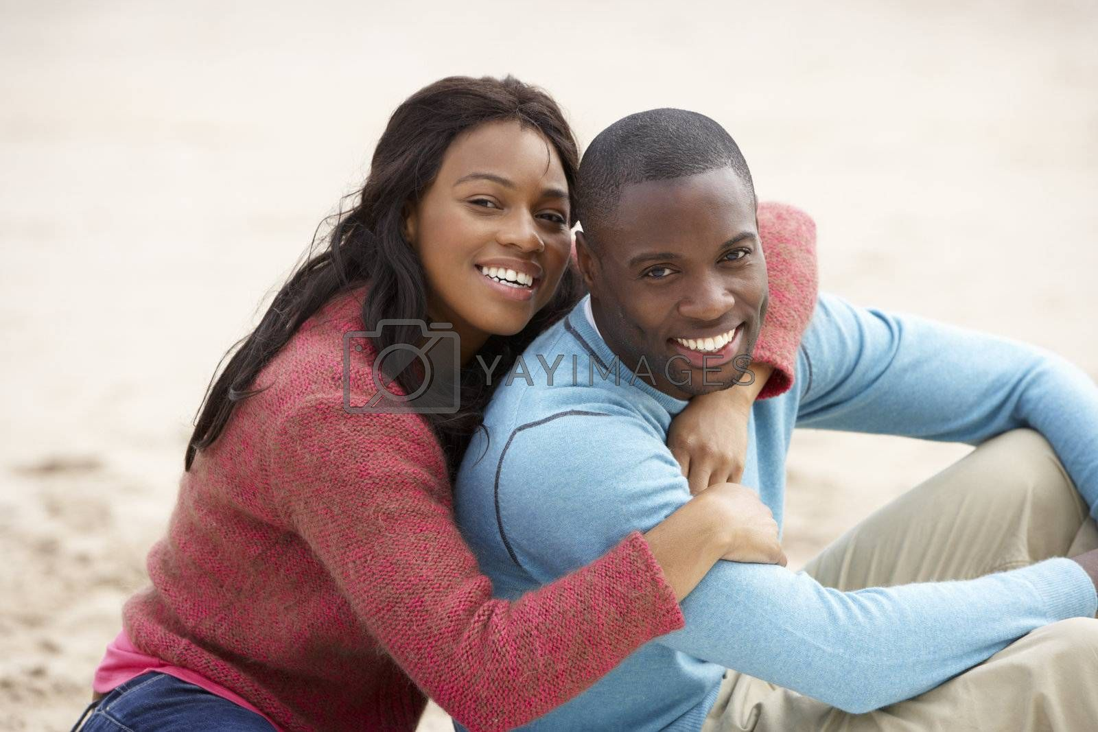 Young couple Embracing on beach