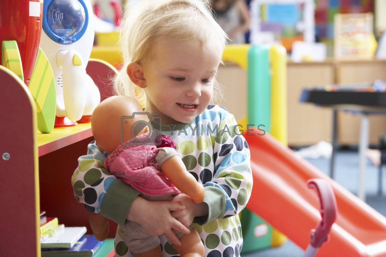 Young girl playing with toys
