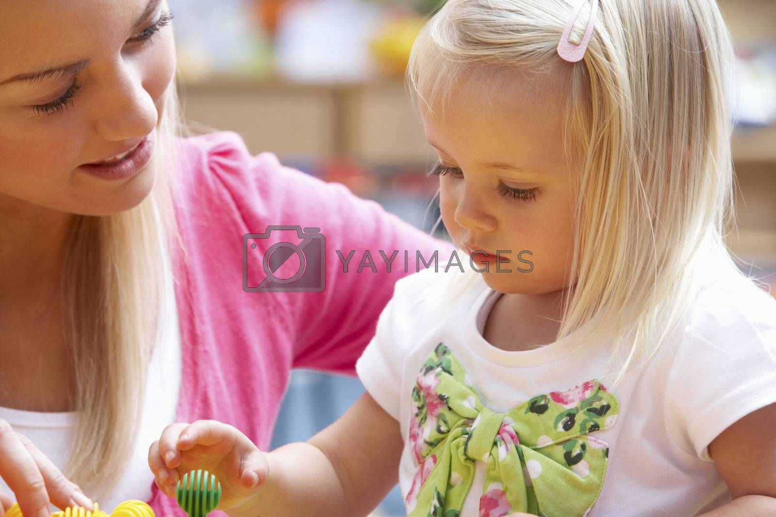 Young woman playing with girl