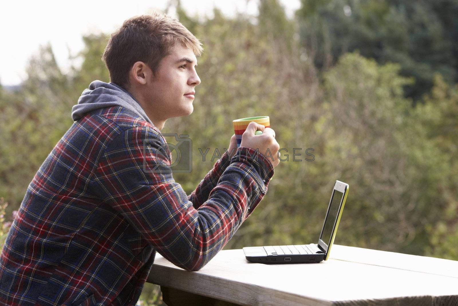 Royalty free image of Young man with laptop computer by omg_images
