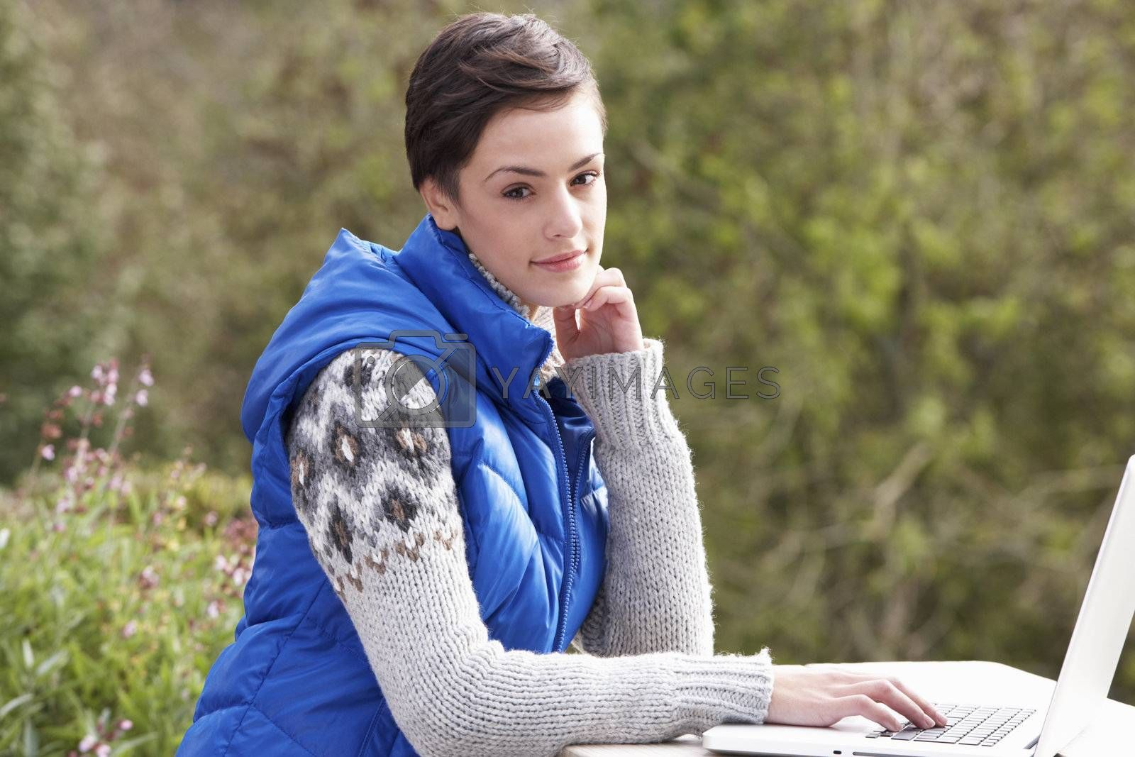 Royalty free image of Young woman with laptop computer by omg_images