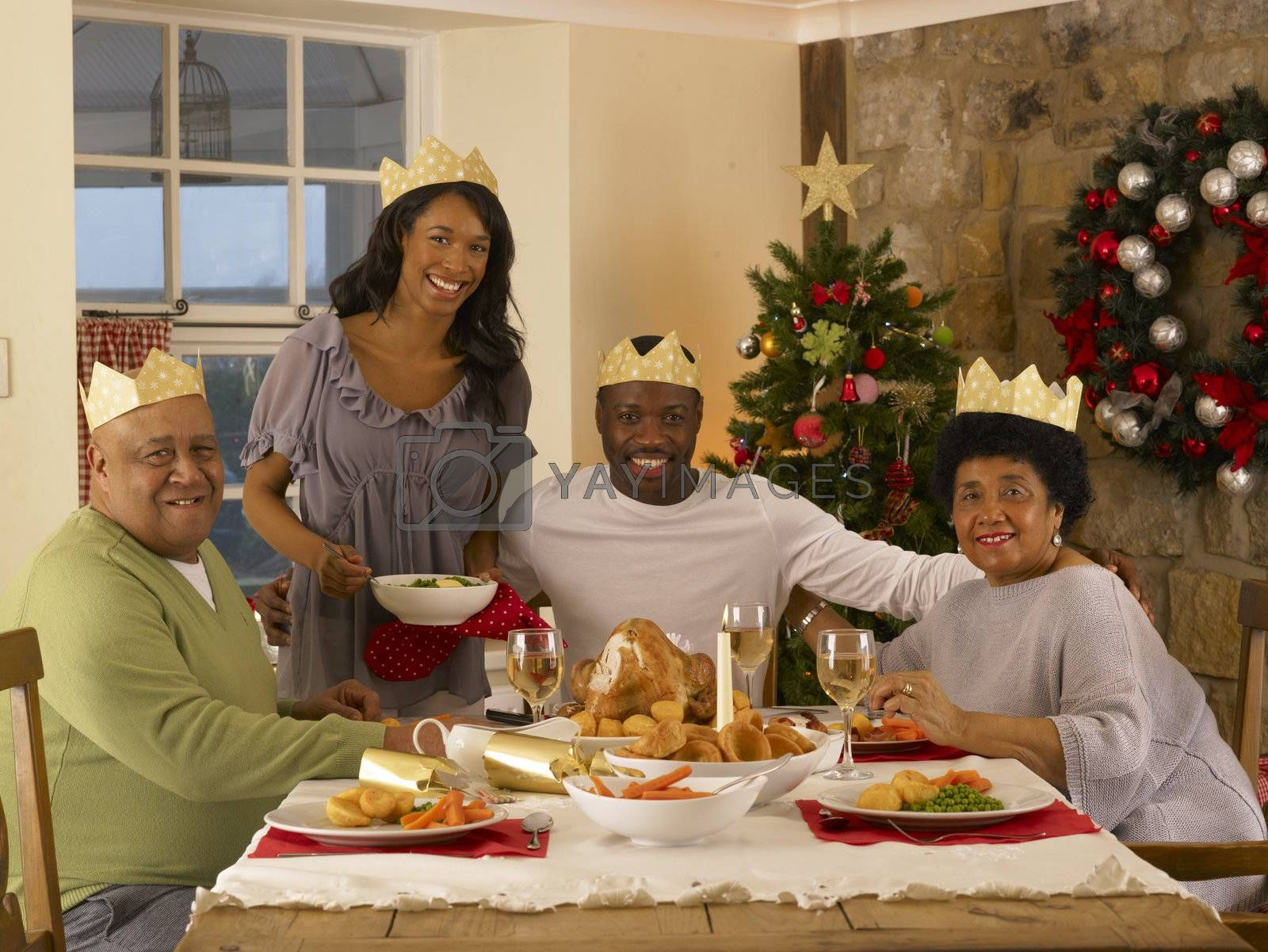 Royalty free image of Adult African American family having Christmas dinner by omg_images
