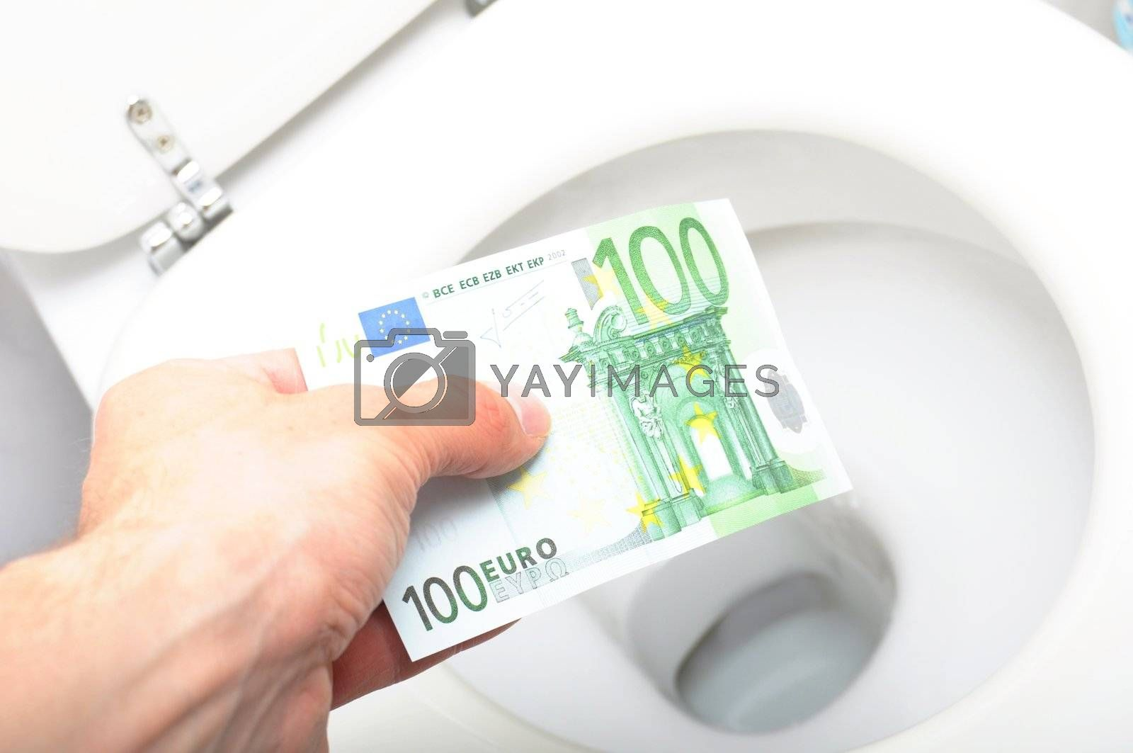 waste of money concept with euro bill and toilet