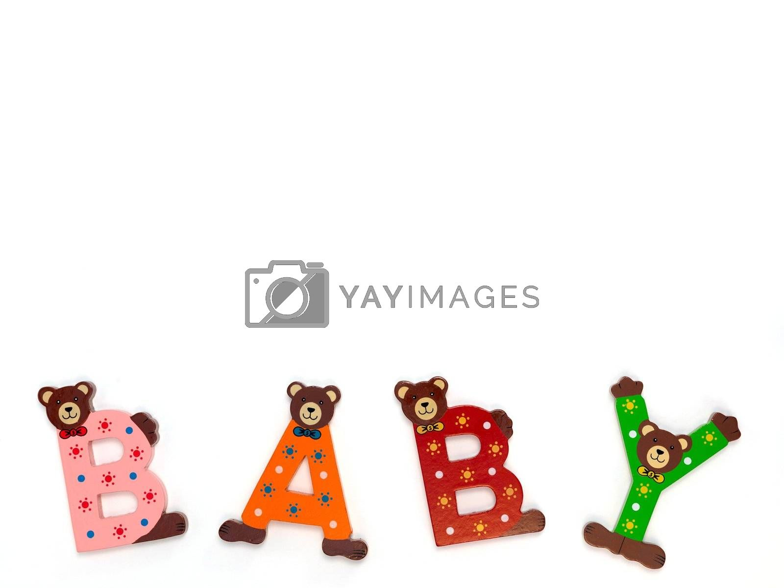 Wooden letters spelling baby isolated against a white background