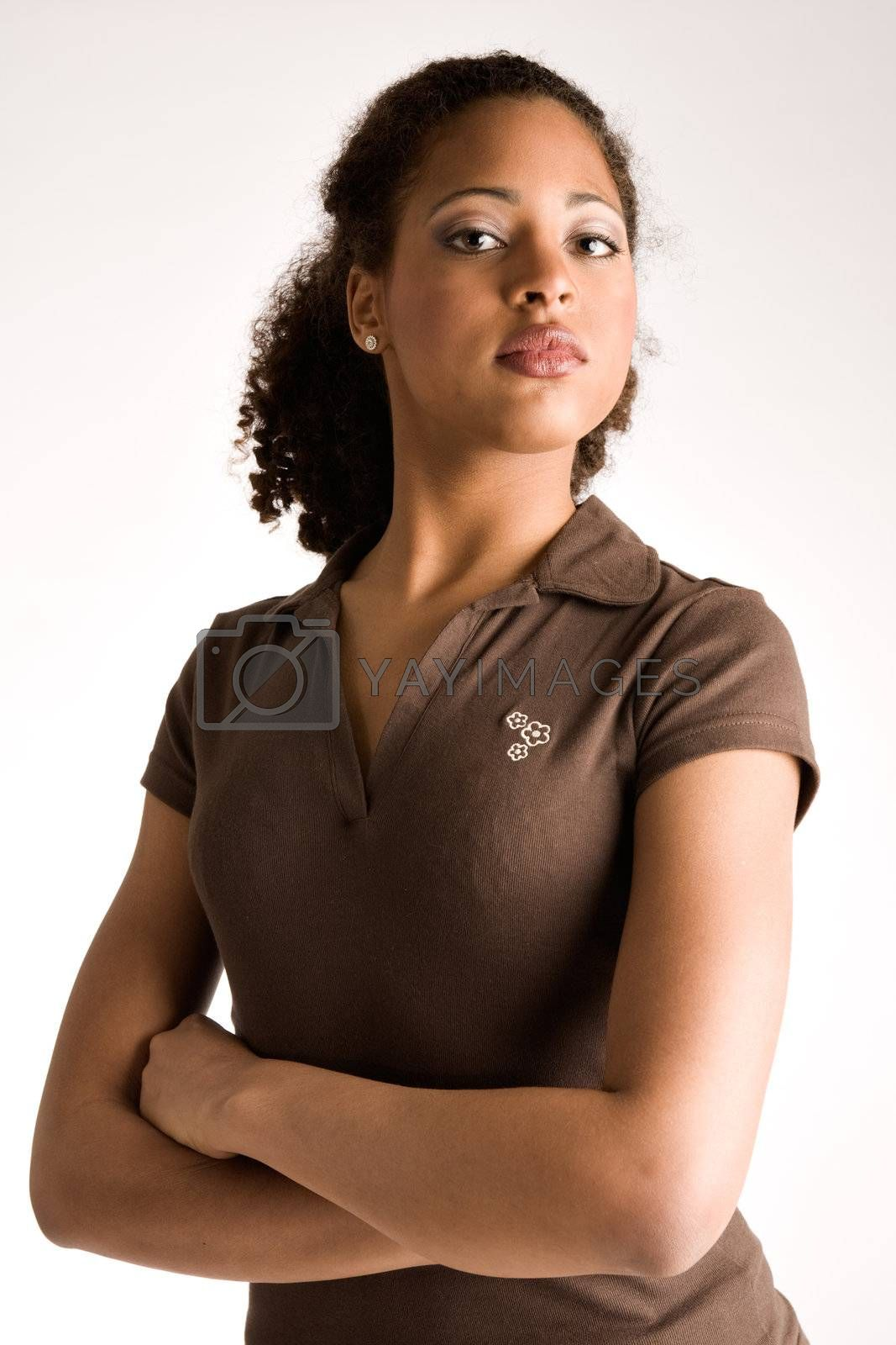 African woman is waiting with her arms crossed