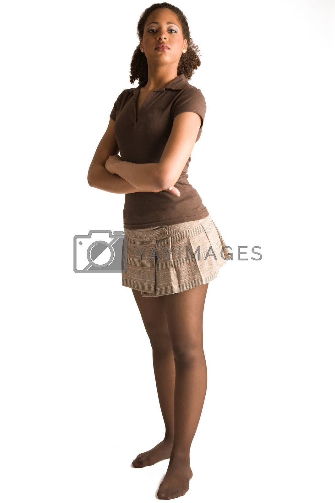 Full body portrait of a african woman with her arms crossed