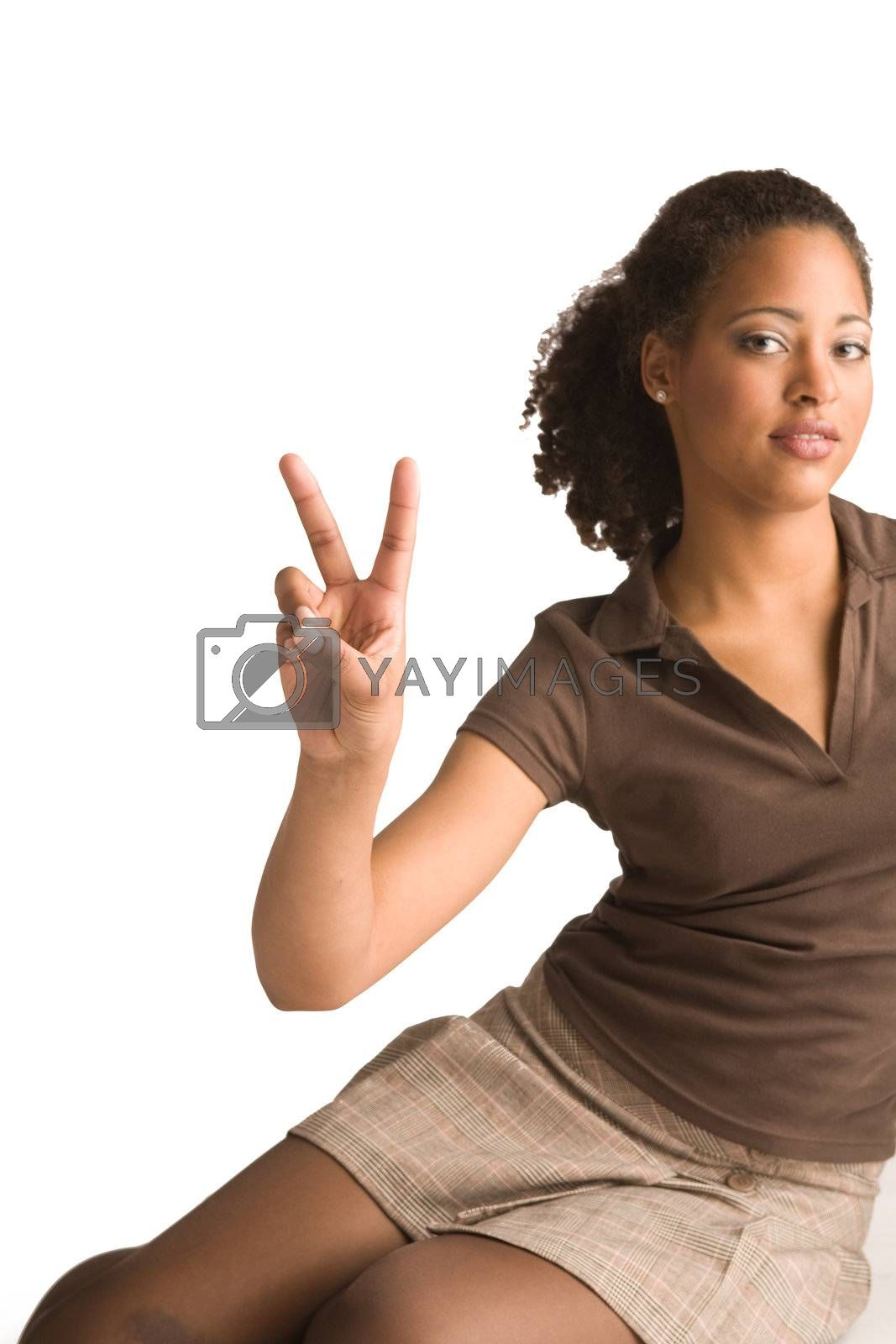 Beautiful african young woman gives a peace sign