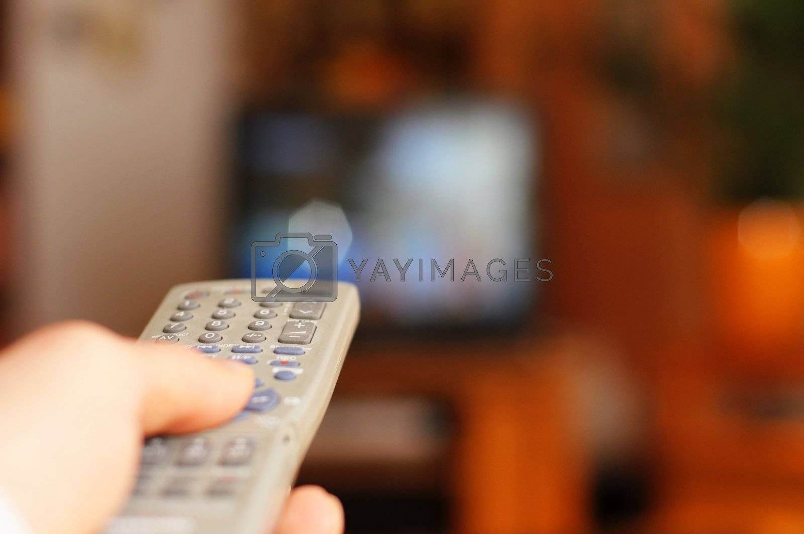 watch tv concept with hand remote control and copyspace for text message