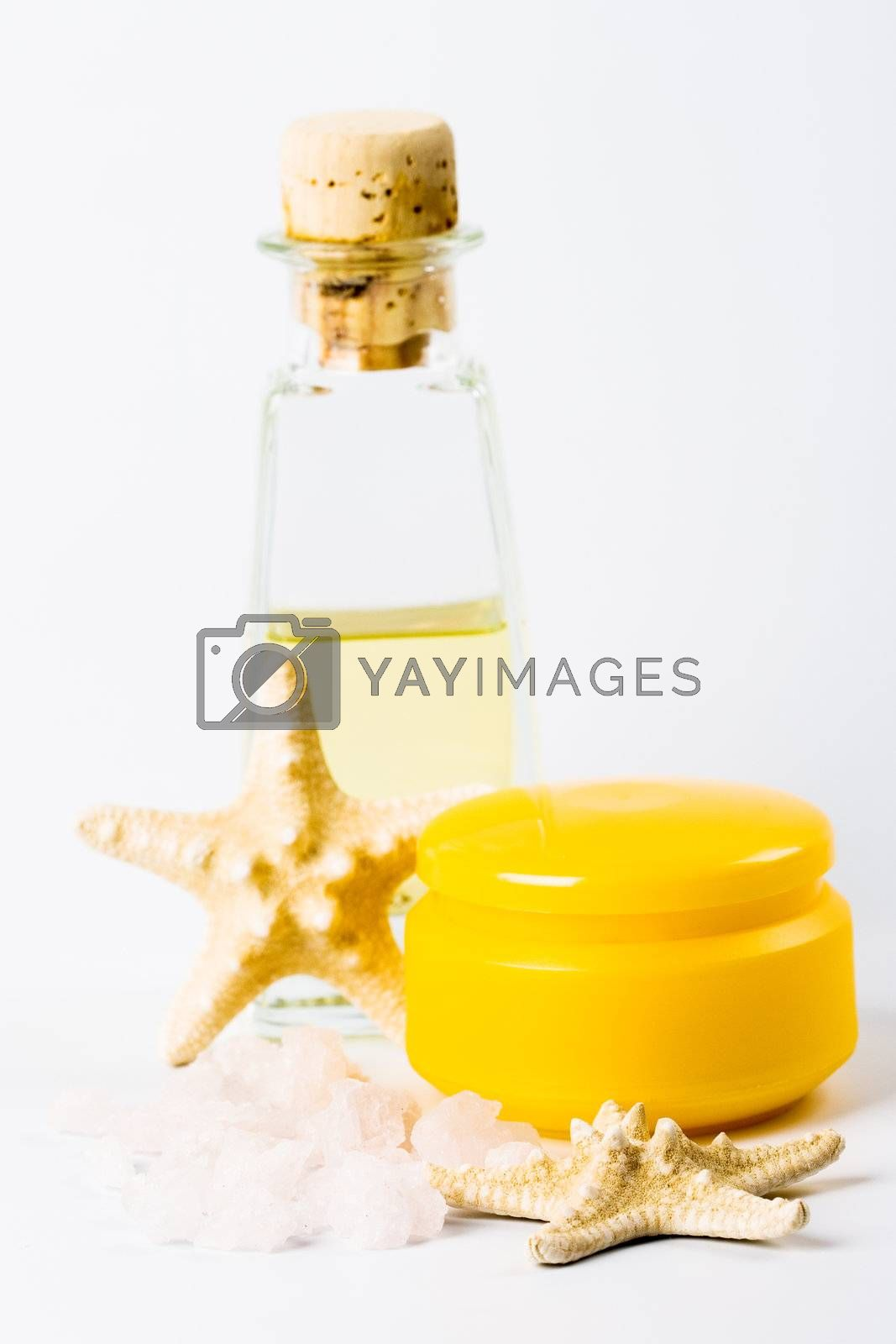 spa products: sea salt, facial creme, oil and stars
