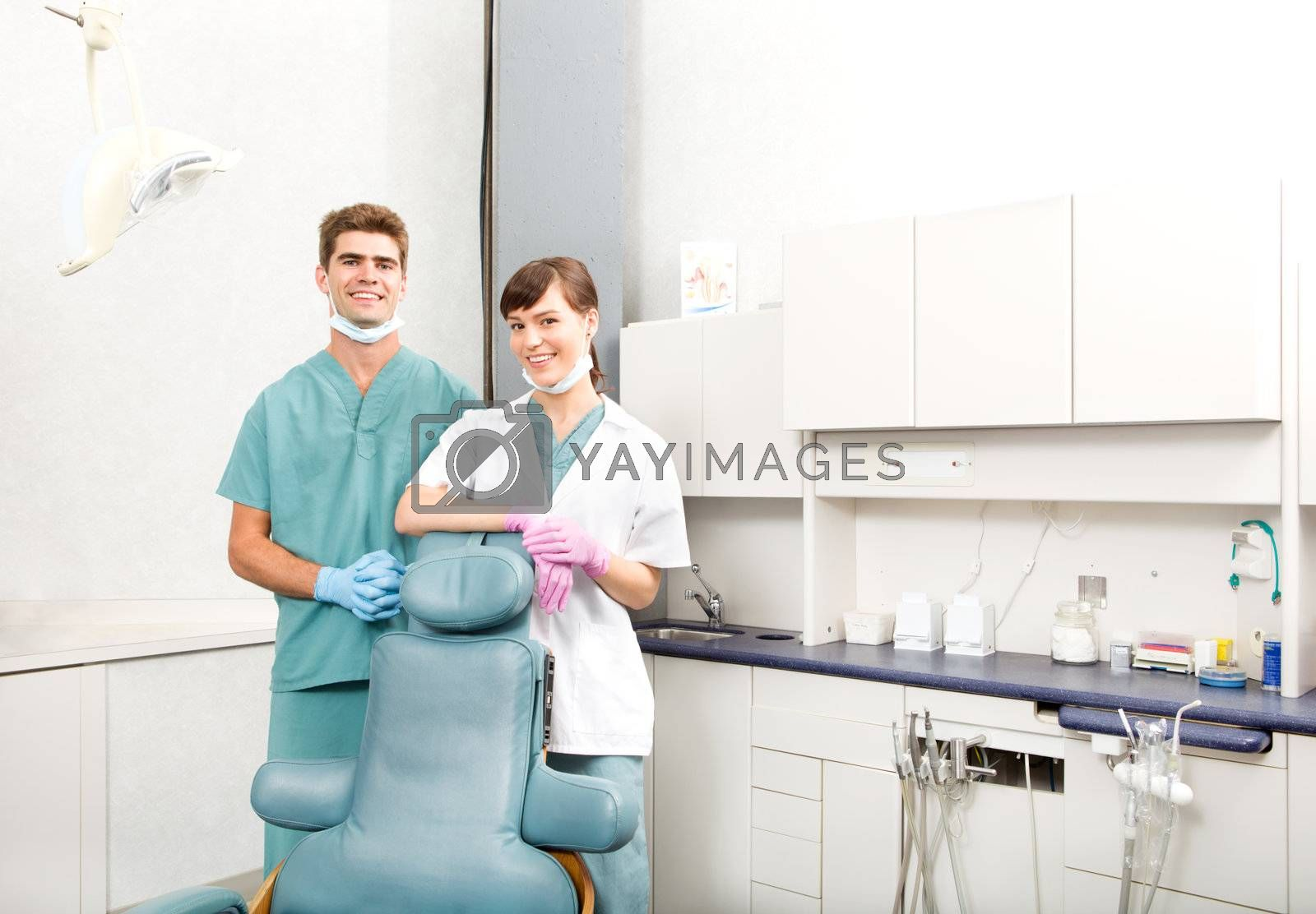 A portrait of a dental team in a clinic smiling at the camera