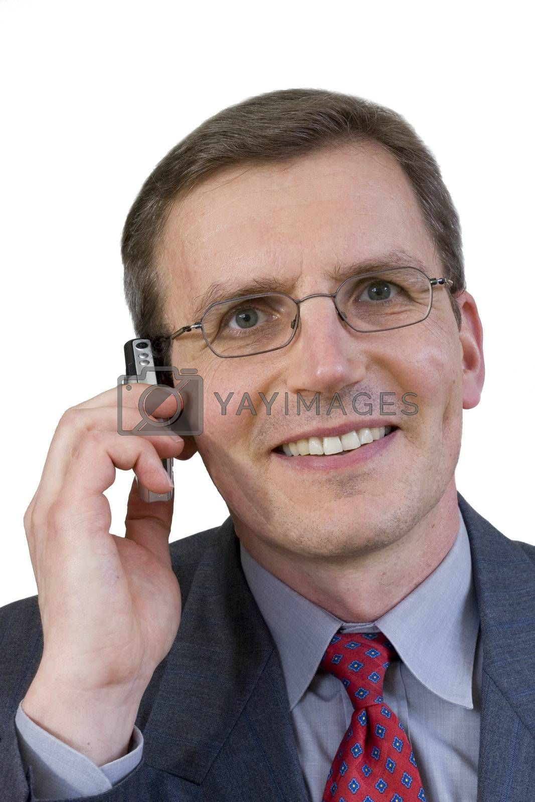Middle-aged smiling businessman making a phone call