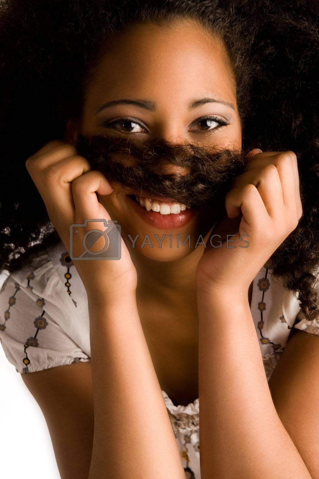 African girl is holding her hair and is smiling