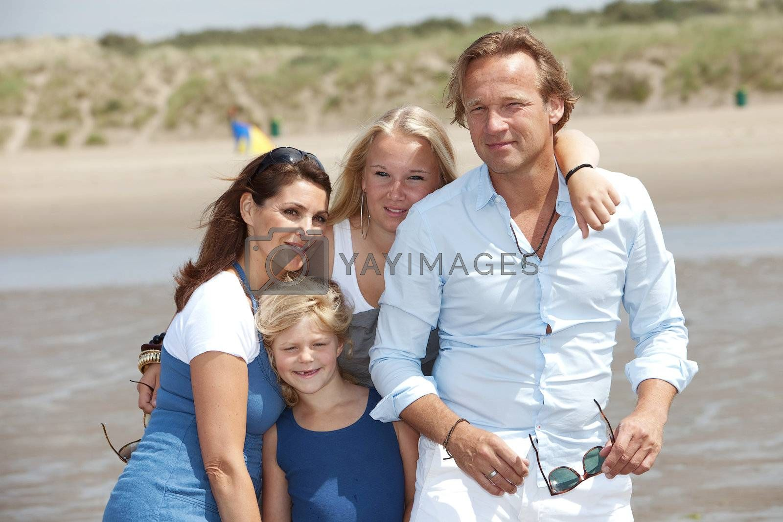 Young attractive family enjoying their summer by the seaside