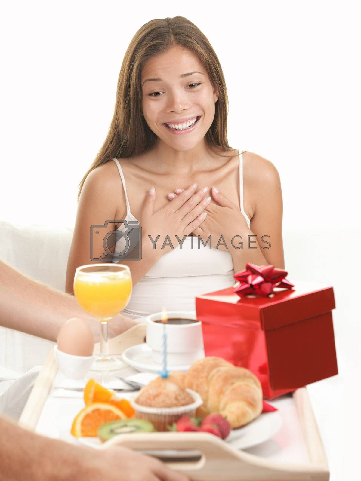 Royalty free image of Birthday gift surprise woman   by Ariwasabi
