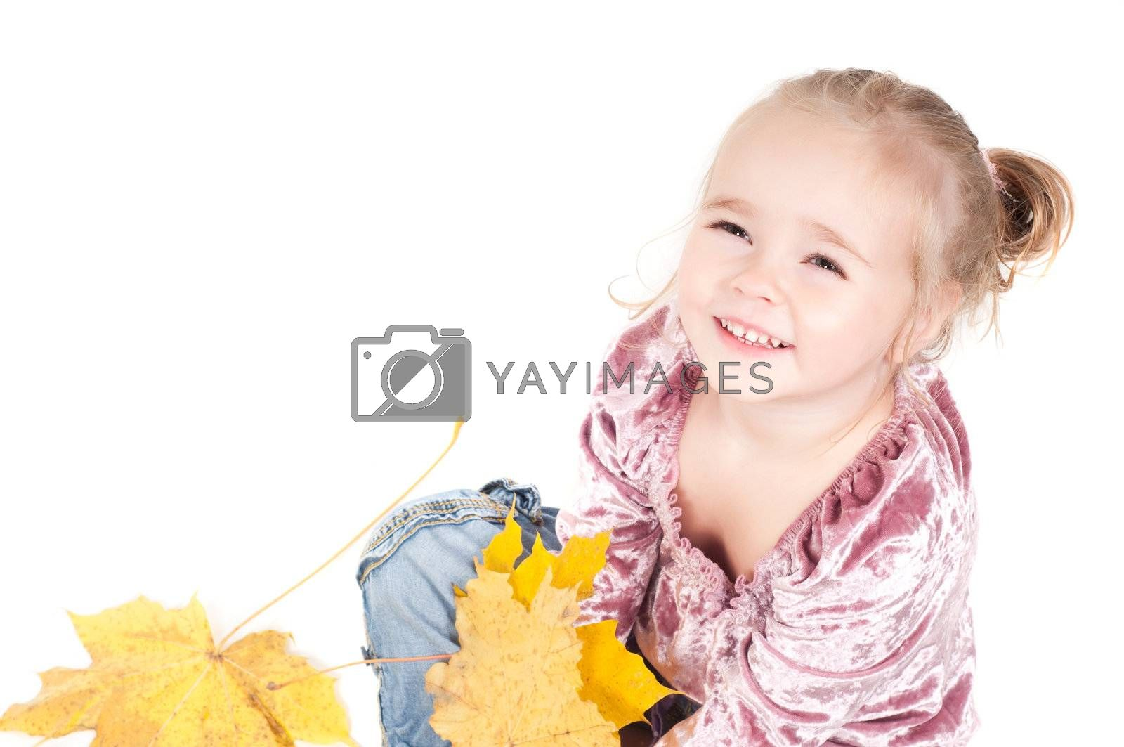 Royalty free image of Toddler with maple leaves by anytka